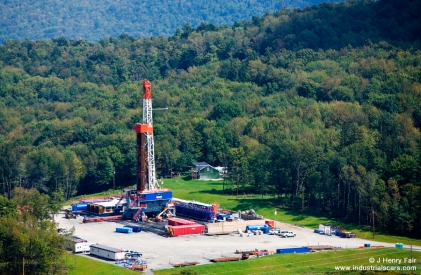 Large gas drilling rig next to house